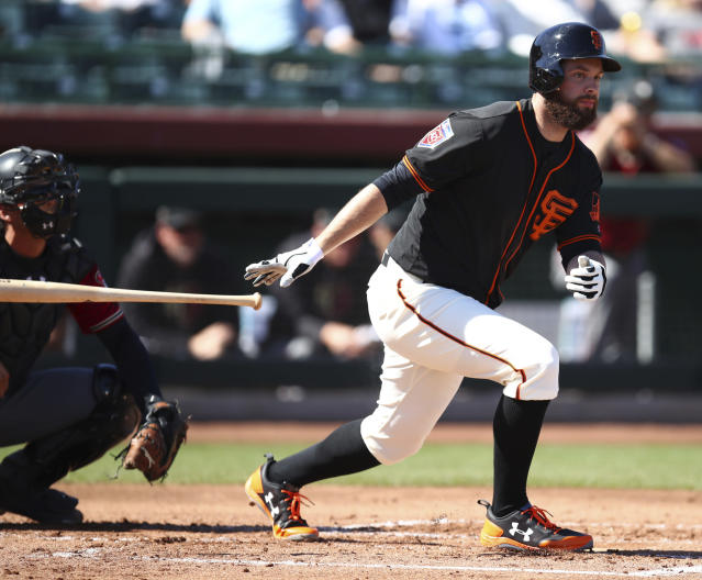"FILE - In this Feb. 27, 2018, file photo, San Francisco Giants' Brandon Belt drops his bat after hitting a single against the Arizona Diamondbacks during a spring training baseball game in Scottsdale, Ariz. First baseman Belt has endured a series of concussions over the past two seasons and he didn't play after Aug. 4 last year. ""It's obvious we're hoping that we don't deal with this again,"" manager Bruce Bochy said. ""Because of the number of concussions sure there's some concern. (AP Photo/Ben Margot, File)"