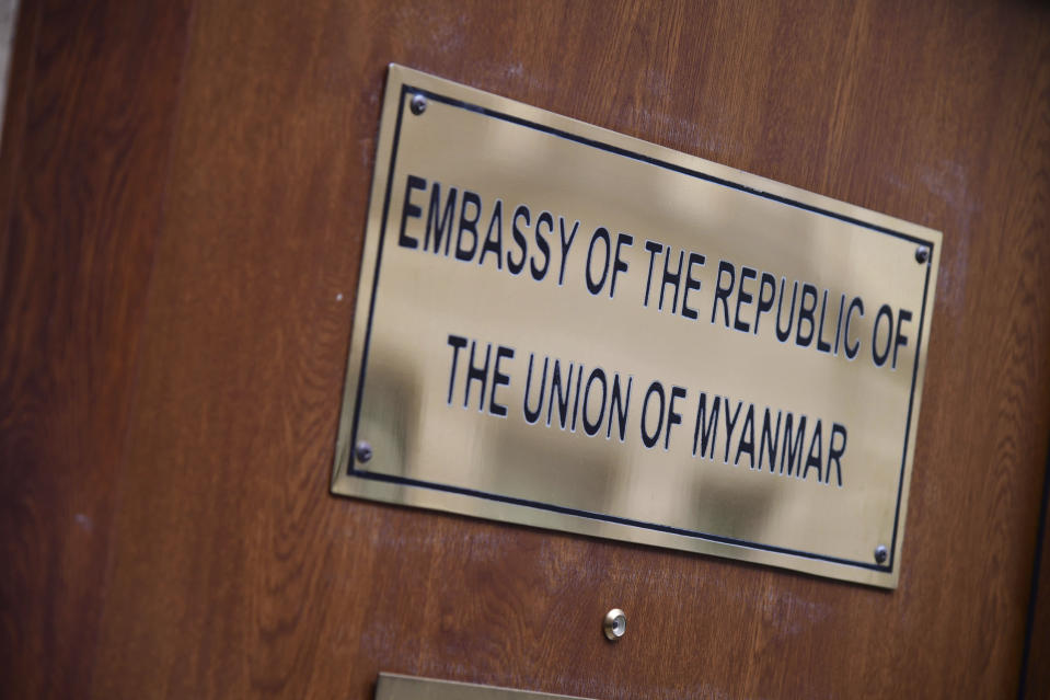 The name plaque outside the Embassy of Myanmar in central London, Tuesday Feb. 2, 2021, after the ambassador was summoned to the Foreign Office on Monday evening following Prime Minister Boris Johnson's condemnation of the military coup in the South East Asian country. Some hundreds of members of the country's Parliament remained confined inside their government housing the country's capital on Tuesday, including Nobel laureate and de facto leader Aung San Suu Kyi. (Ian West/PA via AP)