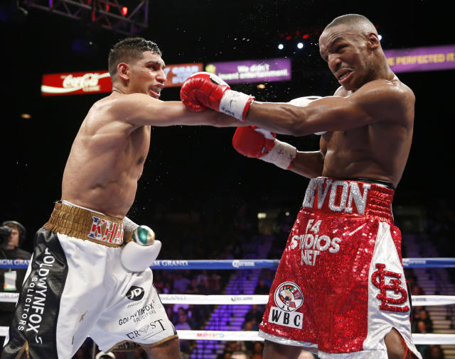 Amir Khan lands a right hand in his 2014 win over Devon Alexander. (AP)
