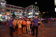 Residents line up for coronavirus testing in the Liwan District in Guangzhou in southern China's Guangdong province on Wednesday May 26, 2021. The southern Chinese city of Guangzhou shut down a neighborhood and ordered its residents to stay home Saturday, May 29, for door-to-door coronavirus testing following an upsurge in infections that has rattled authorities. (AP Photo)