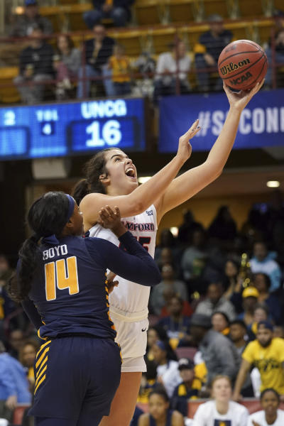 Samford Natalie Armstrong (45) shoots a basket past UNC Greensboro Aja Boyd (14) in the first half of an NCAA women's college basketball game for the Southern Conference championship tournament, Sunday, March 8, 2020, in Asheville, N.C. (AP Photo/Kathy Kmonicek)