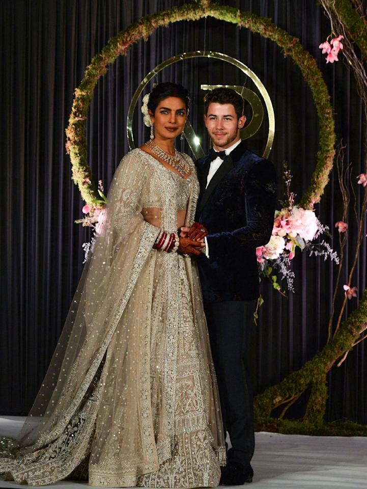 "<p>The couple shared photos from their reception the following week. Chopra wore a lehenga from label Falguni Shane Peacock. According to <a rel=""nofollow"" href=""https://www.instagram.com/p/Bq_HwK1lr1u/"">the label's Instagram</a>, the look 12,000 hours of work to create, and is embroidered with elephant, bird, flower, and butterfly motifs.</p>"