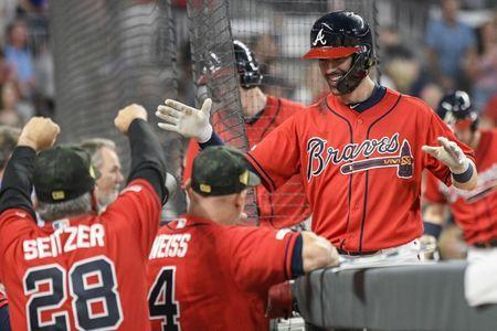 May 17, 2019; Atlanta, GA, USA; Atlanta Braves shortstop Dansby Swanson (7) (right) reacts after hitting a three run home run against the Milwaukee Brewers during the sixth inning at SunTrust Park. Dale Zanine-USA TODAY Sports