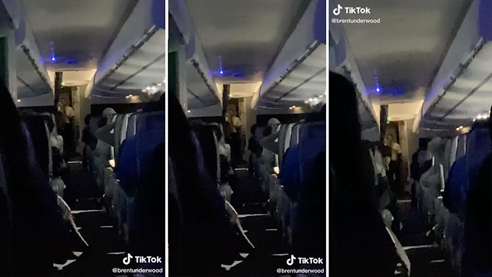 Stills from a video of a flight attendant calling out rude passengers on an American Airlines plane.