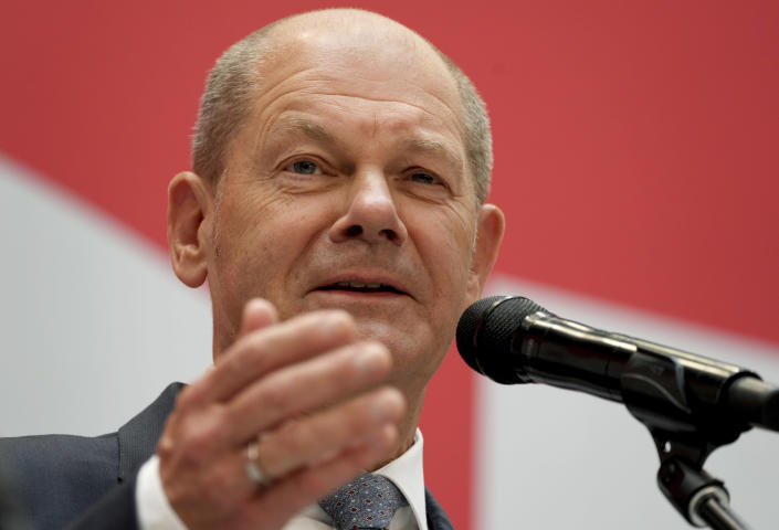 FILE - In this Monday, Sept. 27, 2021 file photo, Olaf Scholz, top candidate for chancellor of the Social Democratic Party (SPD), speaks during a press conference at the party's headquarters in Berlin. As Europe's economic powerhouse Germany embarks on the task of piecing together a new ruling coalition after the knife-edge election on Sunday Sept. 26, 2021, the country need only look to its neighbors, Belgium and the Netherlands, to see how tricky the process can be. (AP Photo/Michael Sohn, file)