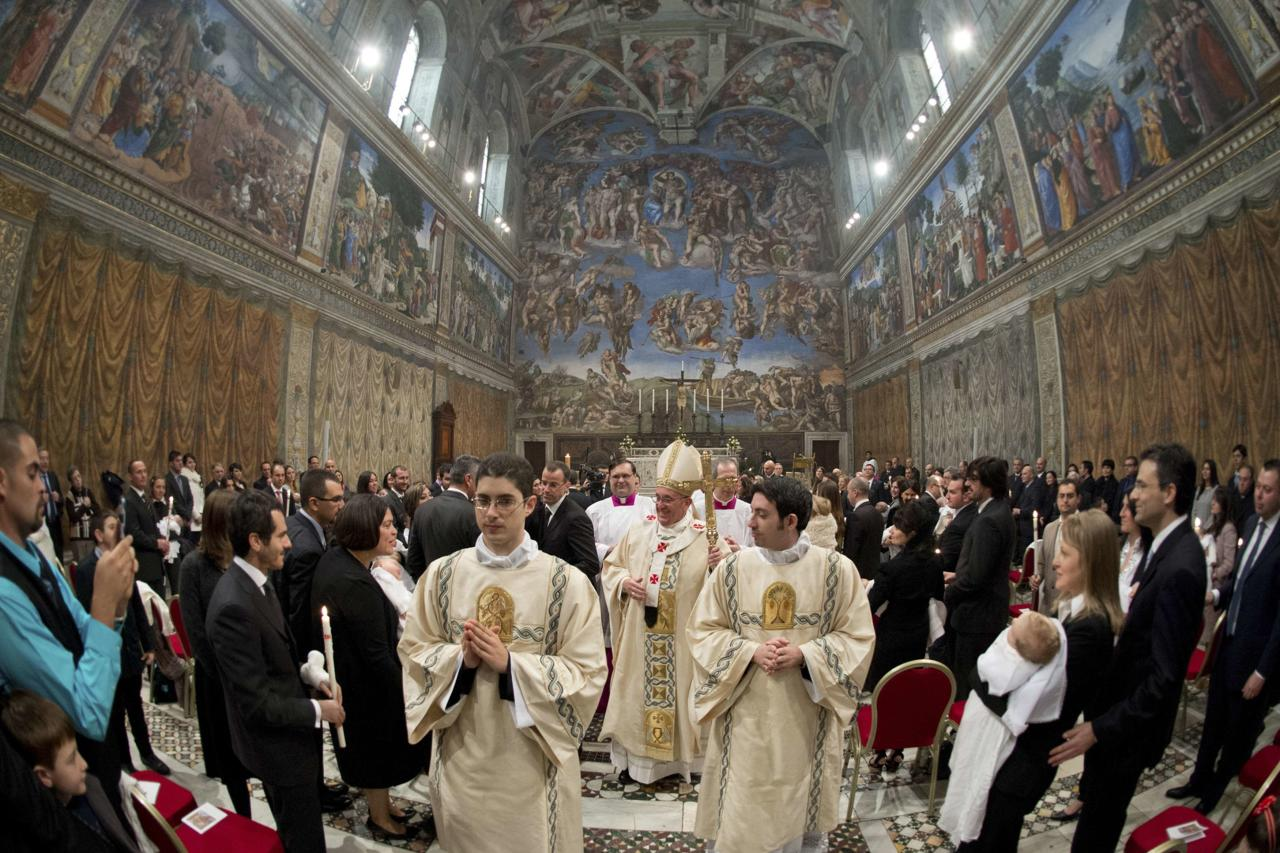 Pope Francis leaves at the end of a mass where 32 babies were baptized in the Sistine Chapel at the Vatican