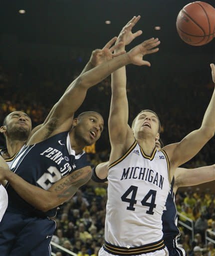Penn State guard D.J. Newbill (2) passes the ball while defended by Michigan forward Max Bielfeldt (44) during the first half of an NCAA college basketball game at Crisler Center in Ann Arbor, Mich., Sunday, Feb. 17, 2013. (AP Photo/Carlos Osorio)