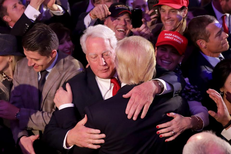"""It was reported that Robert Trump, the younger brother of President Donald Trump, has been hospitalized in New York and is described by several sources as """"very ill."""" In this file photo, Trump (R) hugs his brother Robert Trump after delivering his acceptance speech at the New York Hilton Midtown in the early morning hours of November 9, 2016 in New York City."""