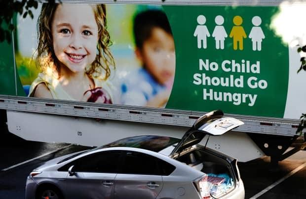 Child poverty has surged during the pandemic, sending families to food banks like this one in Los Angeles. Advocates of this bill say it will cut child poverty in half, through benefits inspired in part by what other countries, including Canada, have done.