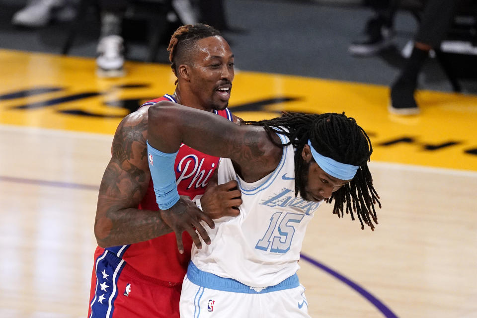 Philadelphia 76ers center Dwight Howard, left, and Los Angeles Lakers center Montrezl Harrell jockey for position during the first half of an NBA basketball game Thursday, March 25, 2021, in Los Angeles. (AP Photo/Mark J. Terrill)