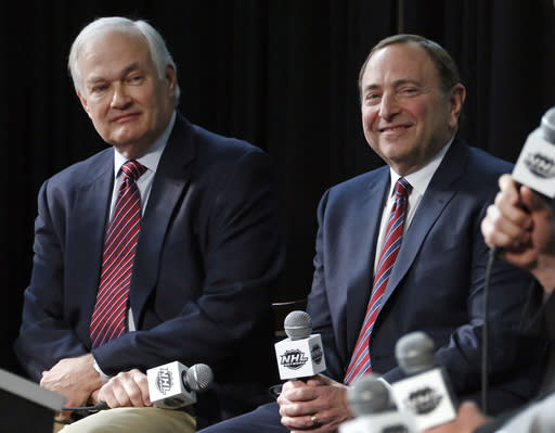 FILE - In this Jan. 24, 2015, file photo, NHL Player's Association executive director Donald Fehr, left, and NHL Commissioner Gary Bettman attend a news conference at Nationwide Arena in Columbus, Ohio. Given the gravity of the pandemic and the abrupt decision to place the NHL season on pause in March, it did not take Bettman and Fehr long to realize they were going to have to work together if play was to resume any time soon. (AP Photo/Gene J. Puskar, File)