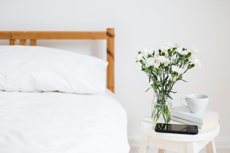 """Ditch flannel or silk: cotton is soft and breathable, which is you want on hot summer nights. If you&rsquo;re the kind of person who has the option to choose between sheets of different thread counts, go for a lower number: <a href=""""https://www.cnn.com/2020/05/24/health/how-to-stay-cool-without-air-conditioning-wellness/index.html"""" target=""""_blank"""" rel=""""noopener noreferrer"""">the lower the thread count</a>, the more breathable the cotton will be.<br /><br />Linen is also a great option, but is usually more expensive.<a href=""""https://www.nytimes.com/2018/06/15/smarter-living/7-ways-to-keep-your-bedroom-comfortably-cool-this-summer.html"""" target=""""_blank"""" rel=""""noopener noreferrer""""> Wirecutter editor Christine Cyr Clisset</a> suggests a cotton bottom sheet, which is smooth and cool, and an airy linen top sheet. <br /><br />Bonus: consider buying a <a href=""""https://www.hunker.com/13412016/the-benefits-of-buckwheat-pillows"""" target=""""_blank"""" rel=""""noopener noreferrer"""">buckwheat pillow</a>. They don&rsquo;t retain as much heat as other pillows do, due to the shape of the buckwheat hulls inside them. Or if you&rsquo;re feeling really fancy, a <a href=""""https://www.goodhousekeeping.com/home-products/pillow-reviews/a25576293/best-cooling-pillow/"""" target=""""_blank"""" rel=""""noopener noreferrer"""">cooling pillow</a>can make a big difference, although they&rsquo;re often pricey."""