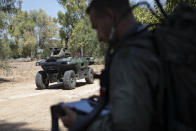 """Israel Aerospace Industries' semi-autonomous four-wheel-drive """"REX MKII"""" is seen at an IAI facility near the central Israeli city of Lod, Thursday, Sept. 9, 2021. Israel's state-owned Israel Aerospace Industries unveiled Monday a state-of-the-art unmanned vehicle their specialists said will be deployed alongside ground troops to assist in combat situations. (AP Photo/Sebastian Scheiner)"""
