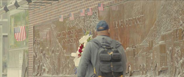 Turning Point: 9/11 and the War on Terror - Vistors at the 9/11 Memorial and Museum from episode GRAVEYARD OF EMPIRES, Season 1 of Turning Point: 9/11 and the War on Terror. Credit: Courtesy of NETFLIX / ©NETFLIX 2021 (Photo: Courtesy of NETFLIX)