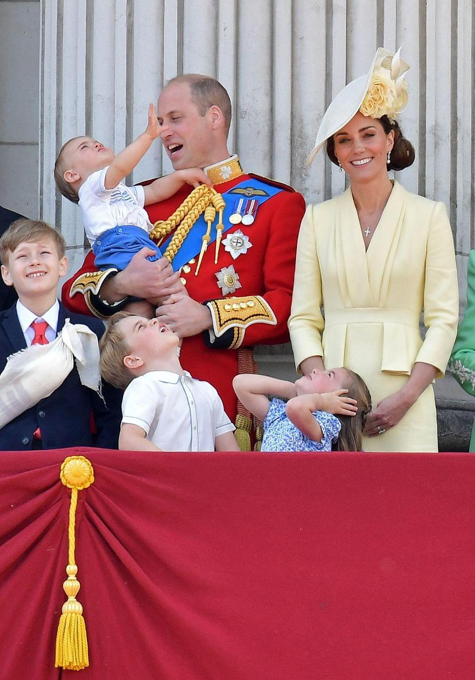 <p>Prince Louis, Prince George, and Princess Charlotte watch a Royal Air Force plane fly by at the Queen's annual Trooping of the Colour celebration.</p>