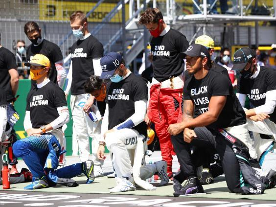 Lewis Hamilton takes a knee before the Austrian Grand Prix but six drivers choose not to (Getty)
