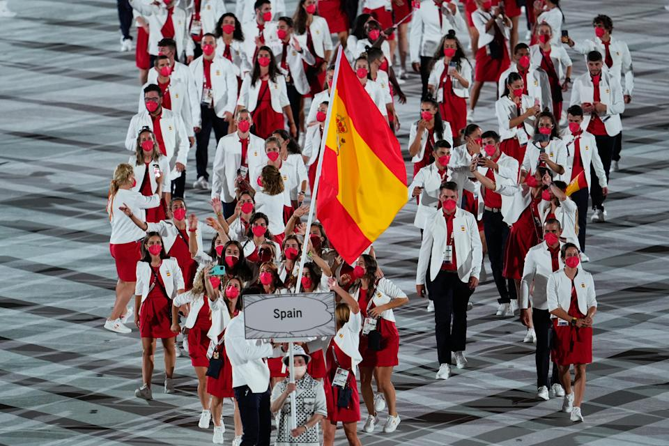 <p>TOKYO, JAPAN - JULY 23: Flag bearers Mireia Belmonte and Saul Craviotto of Team Spain take part in the Parade of Nations during the Opening Ceremony of the Tokyo 2020 Olympic Games at Olympic Stadium on July 23, 2021 in Tokyo, Japan. (Photo by Wei Zheng/CHINASPORTS/VCG via Getty Images)</p>