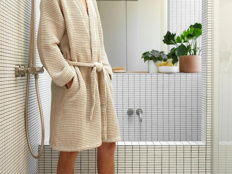 """This robe was purchased nearly 6,000 times over the four days across Thanksgiving to Cyber Monday. Plus, it once scored a 2,000-person wait list. That's a lot of people who really want to relax and unwind in <strong><a href=""""https://fave.co/2tQYucI"""" target=""""_blank"""" rel=""""noopener noreferrer"""">this Waffle Robe from Parachute</a></strong>. It's $120, but there are also <a href=""""https://fave.co/2tQYucI"""" target=""""_blank"""" rel=""""noopener noreferrer""""><strong>other options</strong>,</a> too."""