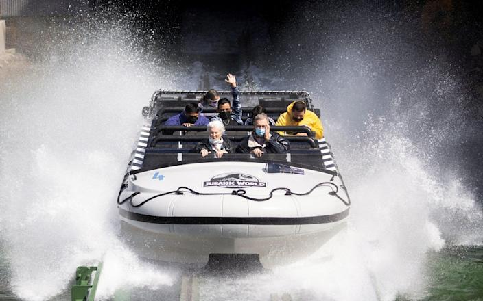 """Guests react while riding """"Jurassic World: The Ride"""" on reopening day of Universal Studios Hollywood during the outbreak of the coronavirus disease, in Universal City - Mario Anzuoni/REUTERS"""