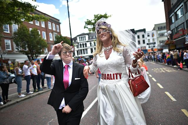 <p>A drag queen and a participant dressed as Donald Trump wave to the crowd as Belfast Gay Pride takes place on Aug. 5, 2017 in Belfast, Northern Ireland. (Photo: Charles McQuillan/Getty Images) </p>