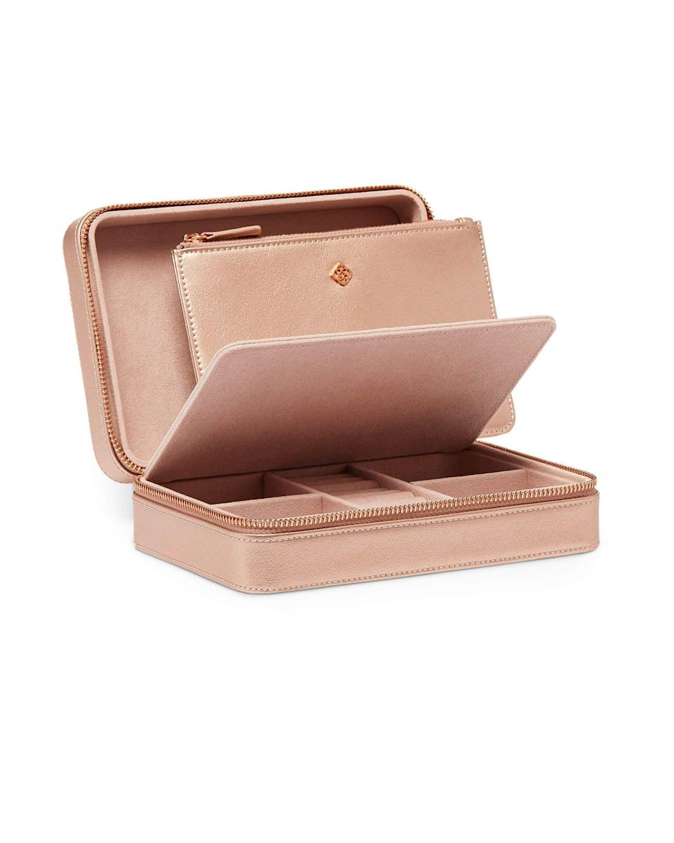 """<p><strong>Kendra Scott</strong></p><p>kendrascott.com</p><p><strong>$98.00</strong></p><p><a href=""""https://go.redirectingat.com?id=74968X1596630&url=https%3A%2F%2Fwww.kendrascott.com%2Fgifts-under-100%2F842177027691.html%3Fcgid%3Dgifts-under-100&sref=https%3A%2F%2Fwww.seventeen.com%2Flife%2Ffriends-family%2Fg722%2Fbest-holiday-gifts-for-mom%2F"""" rel=""""nofollow noopener"""" target=""""_blank"""" data-ylk=""""slk:Shop Now"""" class=""""link rapid-noclick-resp"""">Shop Now</a></p><p>Your mom's jewelry collection rivals your own, so get her this organizer to keep her accessories in order.</p>"""
