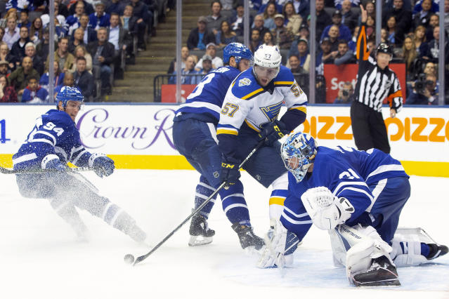 St. Louis Blues left wing David Perron (57) tries to control the puck in front of Toronto Maple Leafs goaltender Frederik Andersen (31) during third-period NHL hockey game action in Toronto, Monday, Oct. 7, 2019. (Chris Young/The Canadian Press via AP)