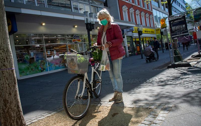 Shoppers out and about in Berlin as the German economy moves out of partial lockdown from the Corona Virus. Wlimersdorfer Strasse, Charlottenburg. - Craig Stennett for the Telegraph