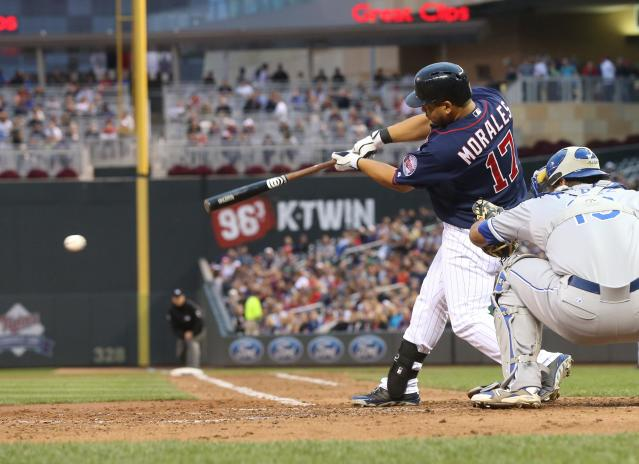 Minnesota Twins' Kendrys Morales hits an RBI single off Kansas City Royals pitcher James Shields in the third inning of a baseball game, Tuesday, July 1, 2014, in Minneapolis. (AP Photo/Jim Mone)