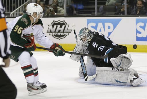 Minnesota Wild right wing Pierre-Marc Bouchard (96) scores past San Jose Sharks goalie Antti Niemi, of Finland, during the second period of an NHL hockey game in San Jose, Calif., Thursday, April 18, 2013. (AP Photo/Marcio Jose Sanchez)
