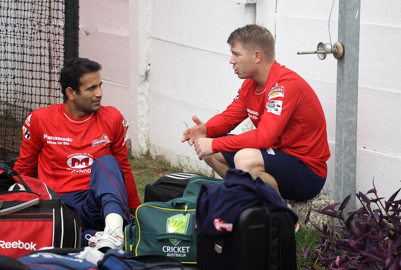 DURBAN, SOUTH AFRICA - OCTOBER 15:  Irfan Pathan and David Warner of Delhi Daredevils attend a training session during the Champions League Twenty20 at Sahara Park Kingsmead on October 15, 2012 in Durban, South Africa. (Photo by Anesh Debiky / Gallo Images/Getty Images)