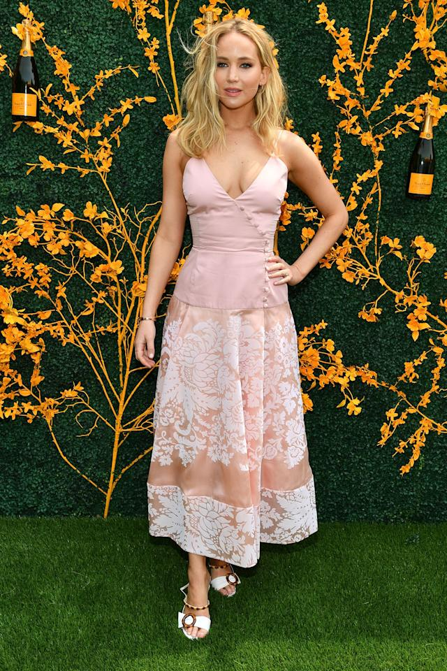 "Jennifer Lawrence attended the 12th Annual Veuve Clicquot Polo Classic in New Jersey weeks after her <a href=""https://people.com/movies/jennifer-lawrence-cooke-maroney-engagement-party/"">engagement party</a>."