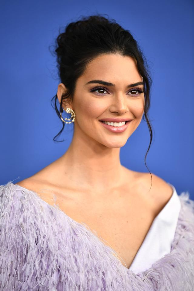 <p>This hair is a little bit of a departure for KJ, but we love it nonetheless. Loose waves thrown into a purposely messy updo give us all the bridal inspo we need.</p>