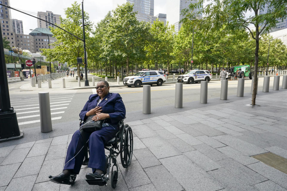 Retired NYPD Detective Barbara Burnette who worked on the World Trade Center pile for 23 days after the terrorist attacks in 2001, smiles while posing for a photo near across the street from the 9/11 Memorial & Museum, Wednesday, Sept. 8, 2021, in New York. Two decades after the collapse of the World Trade Center, people are still coming forward to report illnesses that might be related to toxic dust that billowed over the city after the terror attack. (AP Photo/Mary Altaffer)