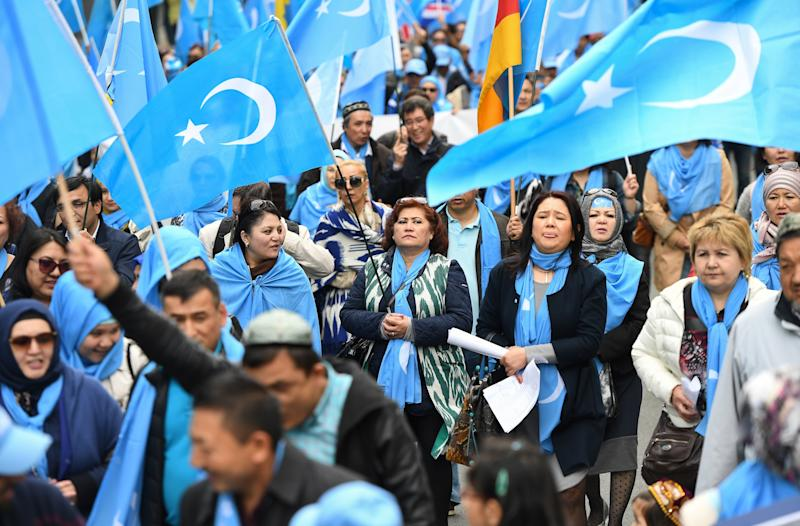 Ethnic Uighurs protesting in Brussels on April 27, 2018, urge the European Union to call upon China to respect human rights in the Chinese Xinjiang region. (EMMANUEL DUNAND via Getty Images)