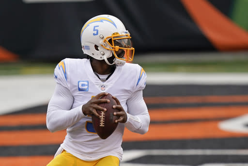 Los Angeles Chargers quarterback Tyrod Taylor (5) looks to throw during the first half of an NFL football game against the Cincinnati Bengals, Sunday, Sept. 13, 2020, in Cincinnati. (AP Photo/Bryan Woolston)