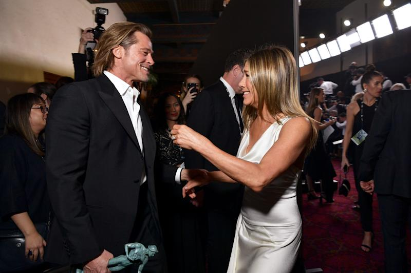Brad Pitt and Jennifer Aniston greet each other backstage.