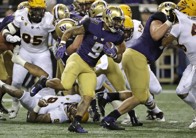 Washington running back Myles Gaskin (9) rushes against Arizona State during the first half of an NCAA college football game Saturday, Sept. 22, 2018, in Seattle. (AP Photo/Ted S. Warren)