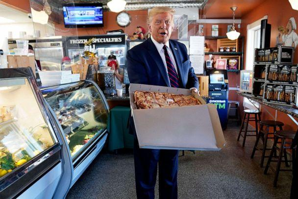 PHOTO: President Donald Trump holds a pizza during a visit to Arcaro and Genell restaurant after speaking at a campaign event, Aug. 20, 2020, in Old Forge, Pa. (Evan Vucci/AP)
