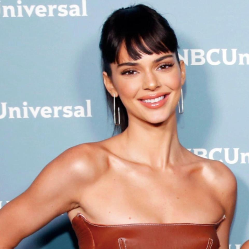 Speaking of hair pieces, Kendall Jenner has been trying out faux fringe as of late, playing around with the length and fullness. These specific bangs feel fresh and new thanks to their shorter length (you can still see those flawless brows) and gentle side-swoop. Use a flatiron to get the fringe as straight as Jenner's and gently sweep the iron to one side. This is an especially clutch style on second (or third) day hair. Just throw your hair into a pony and pop on the bangs for an on-trend look without a ton of effort.