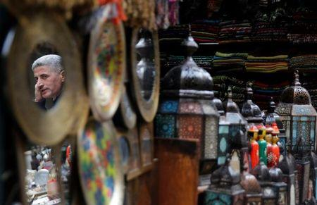 "A shopkeeper waits for customers at a souvenir shop at a popular tourist area named ""Khan el-Khalili"" in the al-Hussein and Al-Azhar districts in old Islamic Cairo"