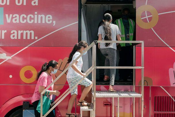 PHOTO: A family enters a pop-up COVID-19 vaccine site, June 5, 2021, in the Jackson Heights neighborhood in the Queens borough in New York. (Scott Heins/Getty Images)