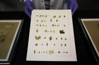 An employee shows recently-discovered scroll fragments of an ancient biblical text at Israel Antiquities Authority laboratories in Jerusalem