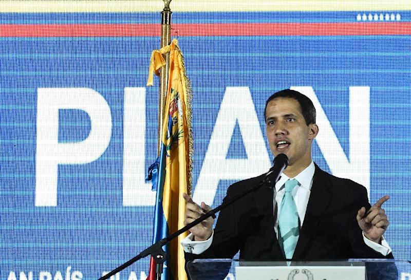 Venezuelan opposition leader and self-proclaimed acting president Juan Guaido presents a plan for his government in Caracas (AFP Photo/Federico Parra                      )
