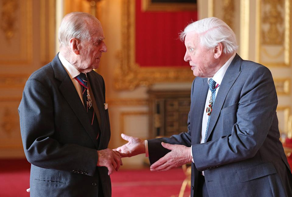 WINDSOR, ENGLAND - MAY 7: Members of the Order of Merit, Prince Philip, Duke of Edinburgh (L) and Sir David Attenborough speak ahead of a luncheon at Windsor Castle on May 7, 2019 in Windosr, England. Established in 1902 by King Edward VII, The Order of Merit recognises distinguished service in the armed forces, science, art, literature, or for the promotion of culture. Admission into the order remains the personal gift of The Queen and is restricted to a maximum of 24 living recipients from the Commonwealth realms, plus a limited number of honorary members. (Photo by Jonathan Brady - WPA Pool/Getty Images)