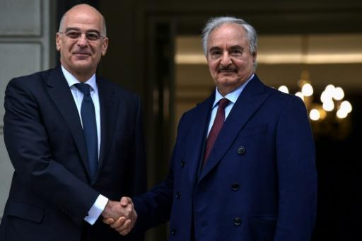Greek Foreign Minister Nikos Dendias (left) welcomed Libyan strongman Khalifa Haftar to Athens