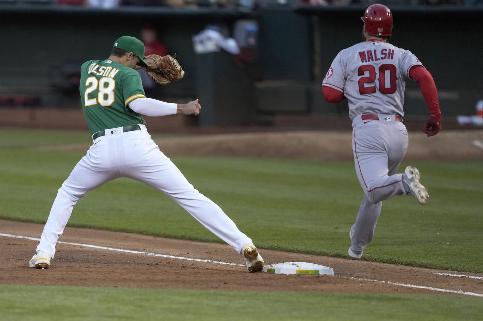 Oakland Athletics first baseman Matt Olson (28) steps to the bag to complete the double play against Los Angeles Angels' Jared Walsh (20) during the fifth inning of a baseball game Friday, May 28, 2021, in Oakland, Calif. Justin Upton was out at second base. (AP Photo/Tony Avelar)