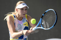 Amanda Anisimova of the U.S. makes a backhand return to Zarina Diyas of Kazakhstan at the Australian Open tennis championship in Melbourne, Australia, Tuesday, Jan. 21, 2020. (AP Photo/Andy Brownbill)