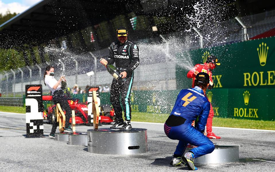 Race winner Valtteri Bottas of Finland and Mercedes GP, second placed Charles Leclerc of Monaco and Ferrari and third placed Lando Norris of Great Britain and McLaren F1 celebrate on the podium during the Formula One Grand Prix of Austria at Red Bull Ring on July 05, 2020 in Spielberg, Austria. - Dan Istitene - Formula 1