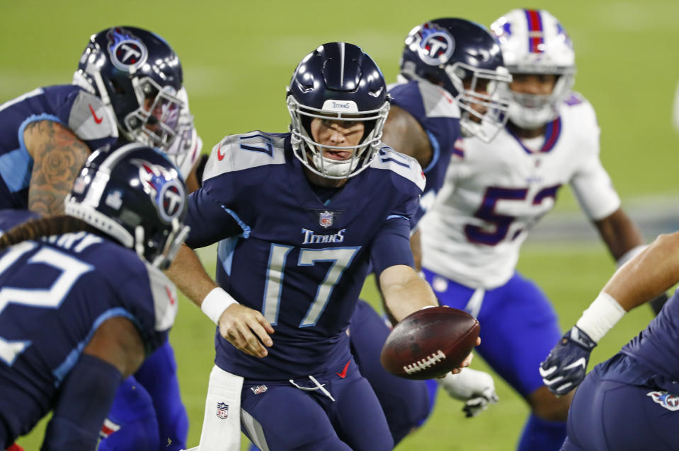 Tennessee Titans quarterback Ryan Tannehill (17) hands the ball off in the first half of an NFL football game against the Buffalo Bills Tuesday, Oct. 13, 2020, in Nashville, Tenn. (AP Photo/Wade Payne)