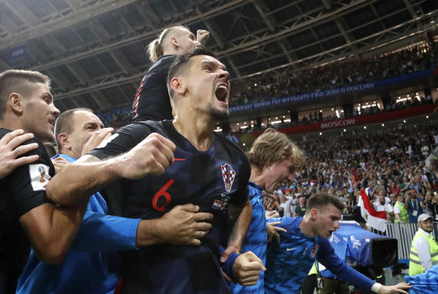 Croatia's Dejan Lovren celebrates after Croatia's Mario Mandzukic scored his side's second goal during the semifinal match between Croatia and England at the 2018 soccer World Cup in the Luzhniki Stadium in Moscow, Russia, Wednesday, July 11, 2018. (AP Photo/Frank Augstein)